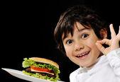 Kid serving burger — Stock Photo