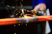 Welder using torch on metal object — Stock Photo