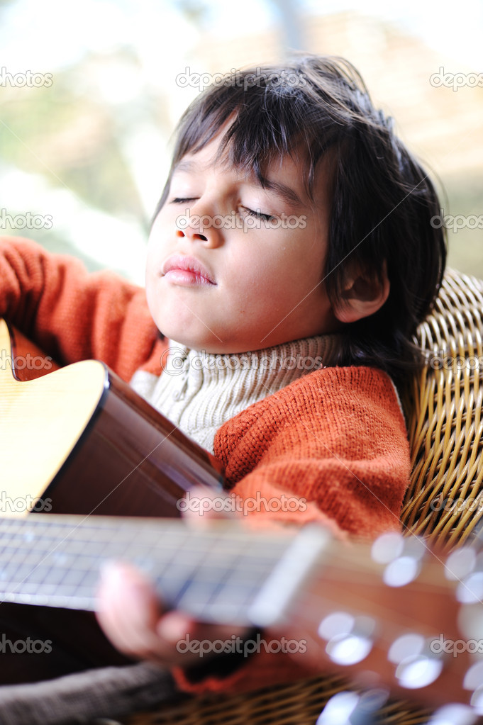 Kid playing guitar at home — Stock Photo #10420751