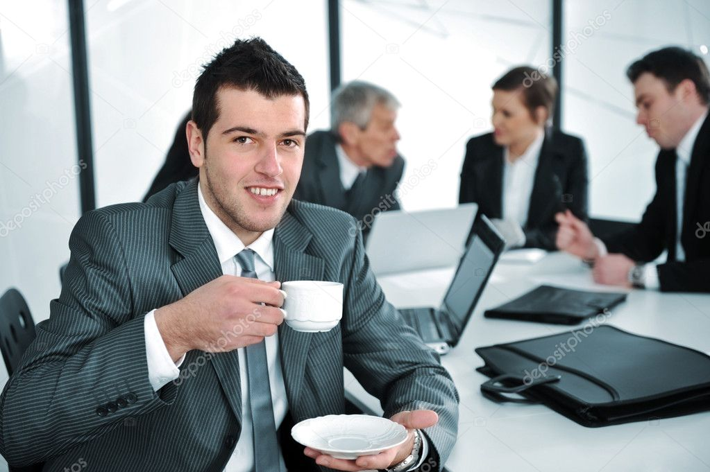 Businessman in business ambience drinking cofee — Stock Photo #10421622
