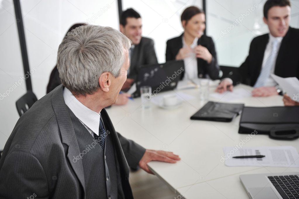 Senior male speaking at a business meeting at office — Stock Photo #10421952