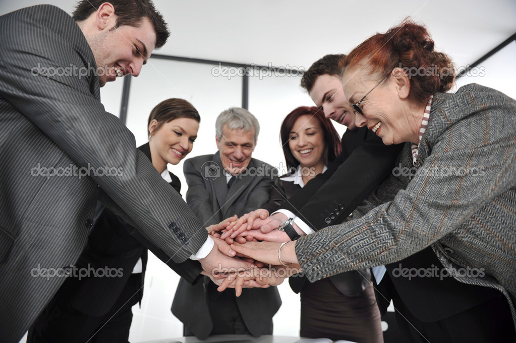 Business partners hands on top of each other symbolizing companionship and unity — Stock Photo #10422081