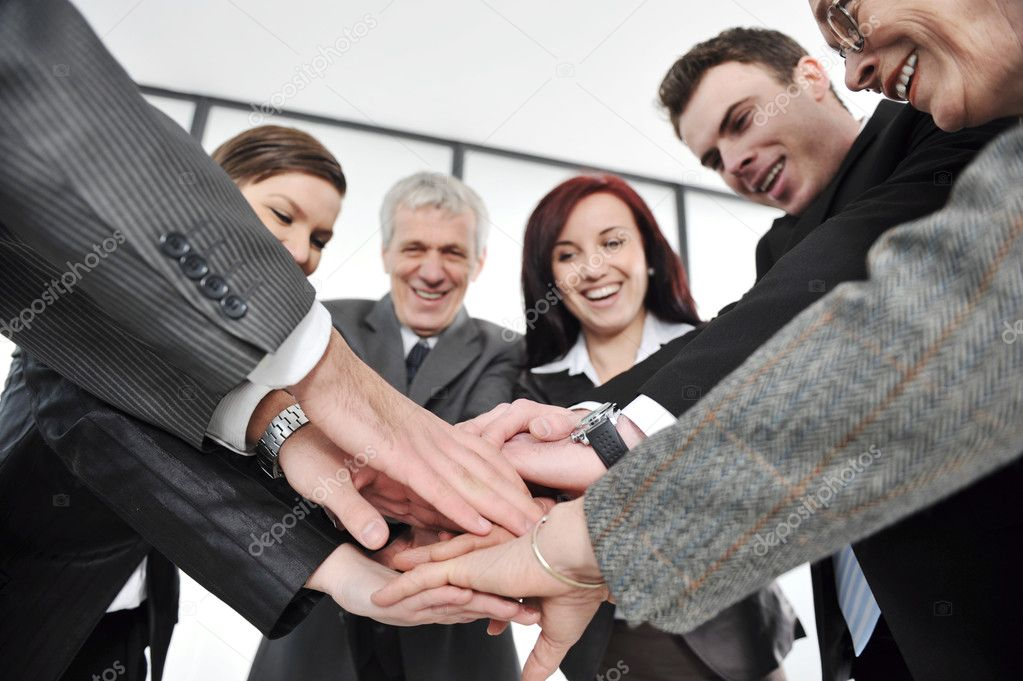 Business partners hands on top of each other symbolizing companionship and unity — Stock Photo #10422087