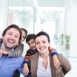 Young family with two children in the shopping mall — Stock Photo