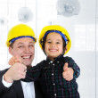 Happy boss and employee together, father and son engineers on work playing - Stock Photo