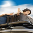 Little boy traveling on the top of the car — Stock Photo #8843787