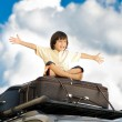 Stockfoto: Little boy traveling on the top of the car