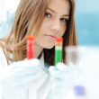 A female scientist working in a Lab with a test tube — Stock Photo #8843794
