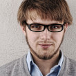 Young confident blond guy with glasses — Stock Photo #8843811