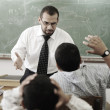 Education activities in classroom, teacher yelling at pupil — Stock Photo #8843863
