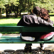 Young loving couple on the bench in park — Stock Photo #8844041