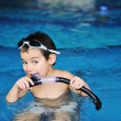 Happy child in a swimming pool — ストック写真