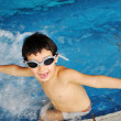 Happy child in a swimming pool — Stock Photo #8844094