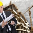 Engineer builder with  blueprint at construction site - Stock Photo
