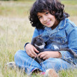 Very cute little girl with cat on meadow — Stock Photo #8844126