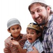 Muslim family, father and two boys - Stock Photo