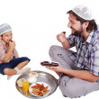 Young muslim man and his son with prepared food for iftar in Ramadan — Stock Photo
