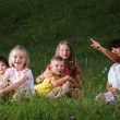 Small happy little group of children outdoor — Stockfoto
