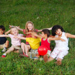 Stock Photo: Small happy little group of children outdoor
