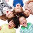 Happy four children together in circle — Stock Photo