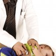 Doctor examining little baby boy — Stock Photo #8844360