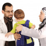 Doctor examining little baby boy — Stock Photo