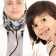Muslim female doctor in hospital examining a little boy — Stock Photo