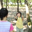 Children playing in wonderfull forest and collecting small pieces of wood — 图库照片