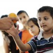 Hungry children in refugee camp, distribution of humanitarian food — Stock Photo #8844501