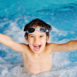 图库照片: Super happy boy inside swimming pool