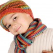 Cute kid with winter clothes isolated in studio — Stock Photo