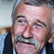 Stock Photo: Common elderly positive man with mustache