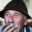 Stock Photo: Closeup Artistic Photo of Aged Man With Grey Mustache Smoking Cigarette