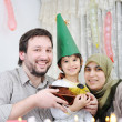 Muslim family birthday — Stock Photo