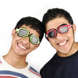 Two funny teenagers with goggles on eyes — Stock Photo