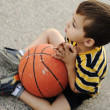 Adorable child holding  the basketball — Stock Photo