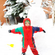 Children on snow with snowman — Stock Photo