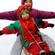 Boy and girl sledging on snow, happiness for brother and sister — Stock Photo