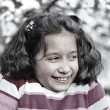 Artistic sepia photo of preteen girl smiling outdor, spring time - Stock Photo