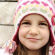 Adorable little girl with positive smiling face — Lizenzfreies Foto