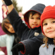 Happy group of children outdoor, winter clothes — Stock Photo