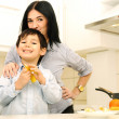 Stock Photo: Mother And Children Prepare A meal,mealtime Together