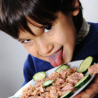 Kid eating fish — Stock Photo