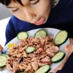 Kid eating fish — Stock Photo #8845214