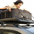 Little boy traveling on bags, the top of the car — Stock Photo