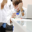 Young medical scientist working in modern lab, research with tubes and note — Stock Photo
