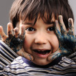 Child with messy hands, green color — Stock Photo