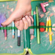 Thumb up over old pencil box — Stock Photo