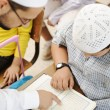 Education activities in classroom at school, Muslim teacher showing Koran t — Stock Photo