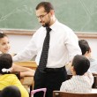 Education activities in classroom at school, happy children learning — Stock Photo #8845572
